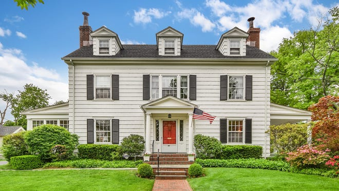 "This classic white clapboard with black shutters and a fire engine-red front door was featured in the first episode of ""Mad Men."" The six-bedroom, four-bath house in New Rochelle was on the market for $1.115 million."