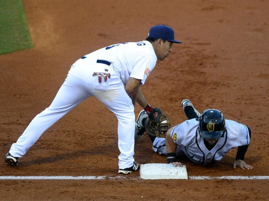 Pensacola Blue Wahoos first baseman Ray Chang reaches for Jacksonville Suns runner Ryan Rieger on Monday in a pick off attempt at Blue Wahoos Stadium.