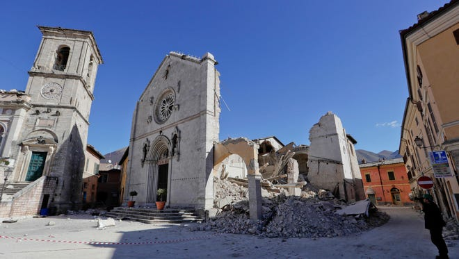The collapsed Cathedral of St. Benedict in Norcia, central Italy, is shown Monday, Oct. 31. The third powerful earthquake to hit Italy in two months spared human life Sunday but struck at the nation's identity, destroying a Benedictine cathedral, a medieval tower and other beloved landmarks that had survived the earlier jolts across a mountainous region of small historic towns.