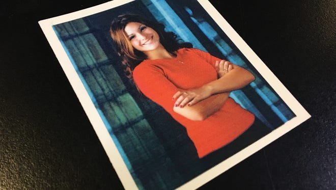 Paula Gurrieri, of Mesa, carries this photo of Lisa Gurrieri with her. Lisa was killed in 2003 while on a camping trip with her boyfriend, and the killer was never identified.