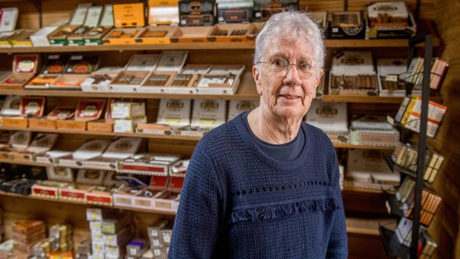 Surrounded by hundreds of cigars, Mary Ann Work stands in the humidor room of Smoking Pleasure, 456 Fulton Street, Suite 128, in the Twin Towers Plaze in Downtown Peoria. Work is closing up her shop on June 26 after nearly 50 years in business.