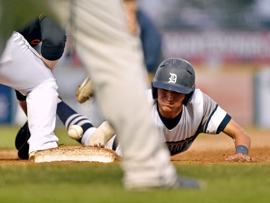 Dallastown's Nick Parker is safe on a pick-off attempt
