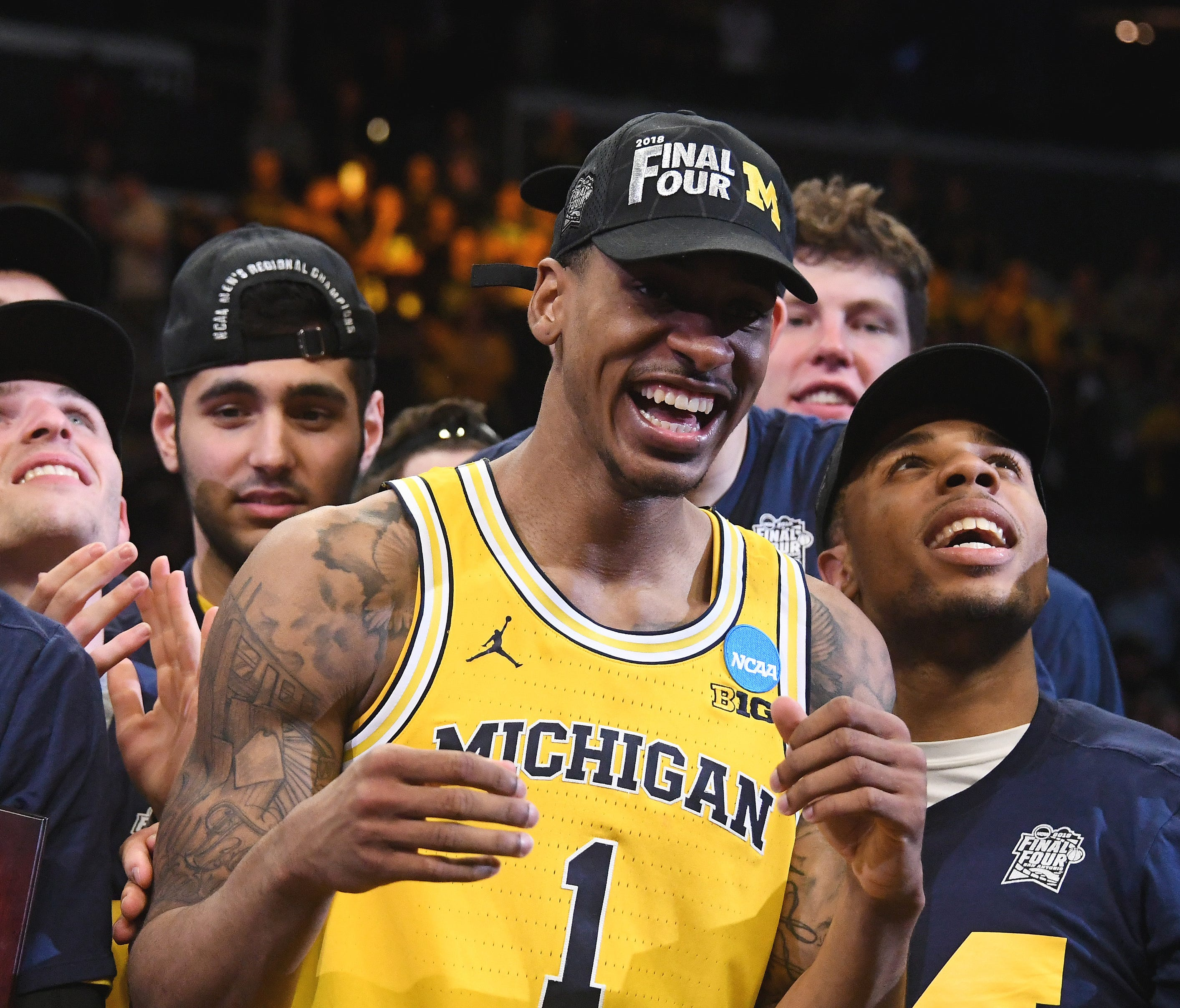 Michigan Wolverines guard Charles Matthews celebrates with teammates.