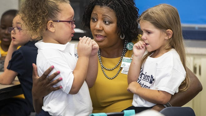Polk County Public Schools Superintendent Jacqueline Byrd consoled kindergarteners during their first day at school in August.