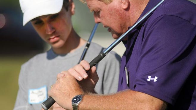 PGA professional Steve Grimes, right, co-owner of Green Acres Golf Course, 3594 Gooding Road, instructs Braytton Krock, 14, of Kenton, during a Heart of Ohio Junior Golf Association golf camp. Steve and his brother John will be the honorees at this year's Marion County Men's Amateur Championship.