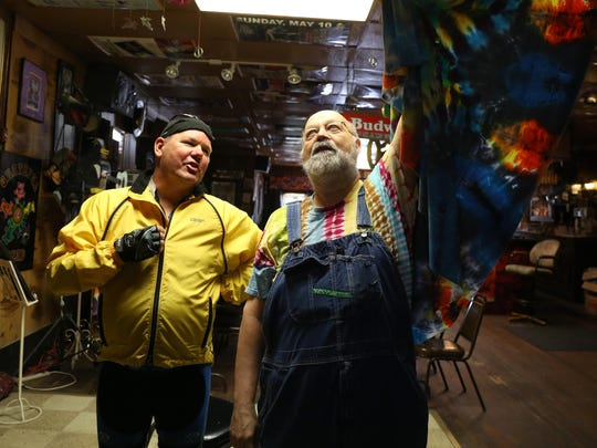 Byron Stuart, owner of Byron's bar in Pomeroy, shows some of the concert memorabilia as he speaks with RAGBRAI director T.J. Juskiewicz during the 2015 RAGBRAI preride on Monday, June 1, 2015. Byron's will feature live music for riders who choose to do the gravel loop.