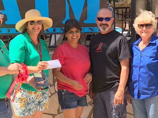 Alicia Armstrong of Team Bravo accepted the top prize in the Menudo Cookoff for the third straight year. Pictured from left are Matt Robinson, Jessica Etcheverry, Armstrong, Mayor Benny Jasso and Luna County Commissioner Linda Smrkovsky.