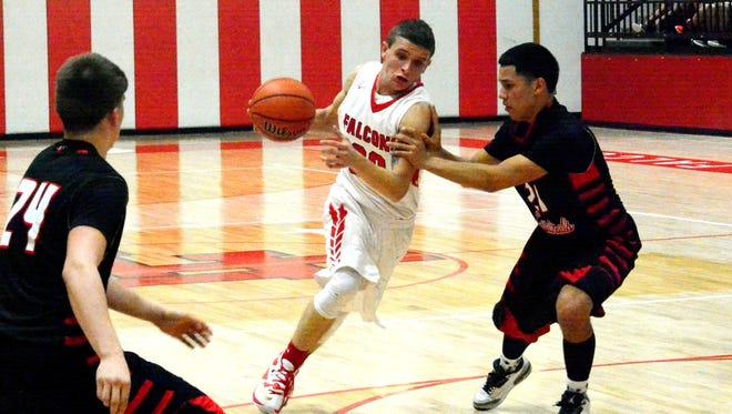 Loving junior forward Alex Gonzalez attacks the basket in the third quarter Tuesday.