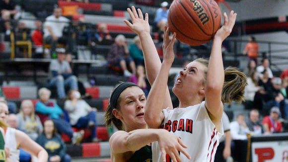 Pisgah's MaeAnna Norris attempts to shoot as Wilkes Central's Hailey Workman guards February 20, 2018 in the first round of playoffs in Canton. Wilkes Central won, 49-36.