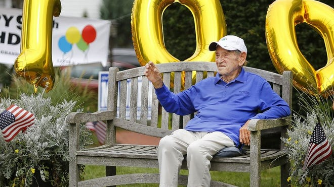 Edward Smith of North Weymouth turns 100 on Aug. 4 and his friends and relatives gave him a drive by birthday celebration on Sunday August 2, 2020