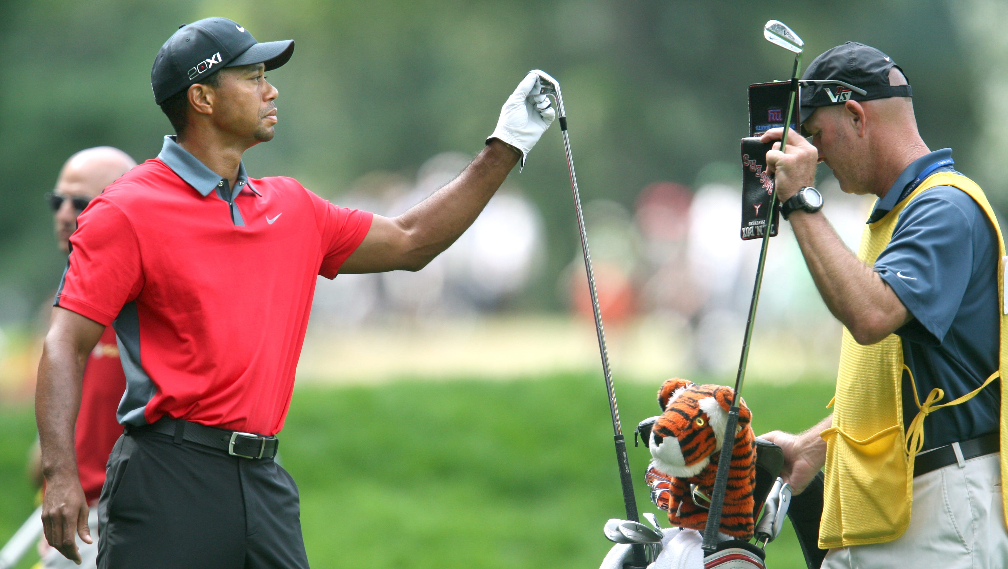 Tiger Woods picks up a club on the 4 fairway.