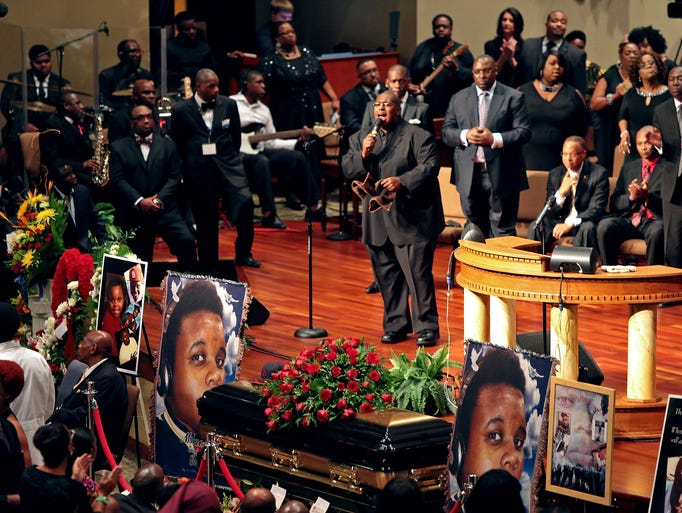 People attend the funeral of slain teenager Michael Brown on Aug. 25 at the Friendly Temple Missionary Baptist Church in St. Louis. Brown was shot and killed on Aug. 9 by a police officer in Ferguson, Mo.