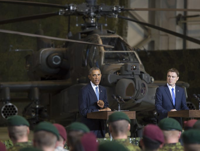 President Obama, left, speaks next to Estonian Prime Minister Taavi Roivas as they meet with U.S. and Estonian troops on Sept. 3 at a hangar at Tallinn airport in Tallinn, Estonia.