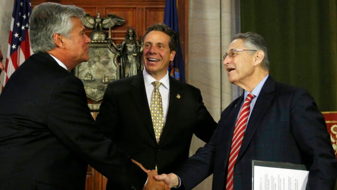 Former Senate Majority Leader Dean Skelos, R-Rockville Centre, left, New York Gov. Andrew Cuomo, center, and former Assembly Speaker Sheldon Silver, D-Manhattan, leave a June 2014 news conference in Albany.