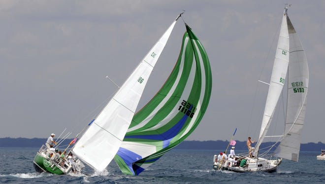 Shamrock, of Bayview Yacht Club, heels over and dips its spinnaker into the water during the 2013 Mackinac race. The 94th running of he race is July 14.