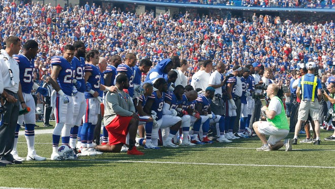 Buffalo Bills players kneel in protest during the National Anthem before a game against the Denver Broncos at New Era Field in September.
