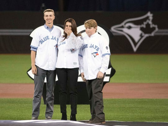 Mar 29, 2018; Toronto, Ontario, CAN; Toronto Blue Jays player Roy Halladay wife and sons in attendance for a special dedication ceremony before the home opener against the New York Yankees at Rogers Centre. Mandatory Credit: Nick Turchiaro-USA TODAY Sports