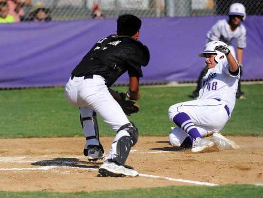 Wylie Intermediate's Marcus Garcia slides safely into