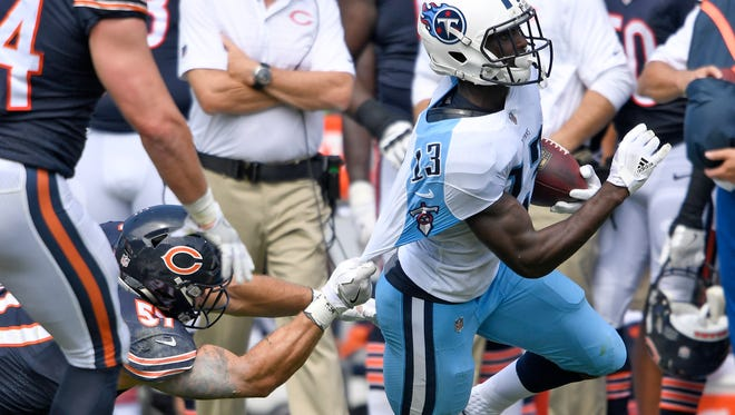 Bears linebacker Dan Skuta (57) hangs on but can't make the stop on Titans wide receiver Taywan Taylor (13) in the second half Sunday, Aug. 27, 2017, at Nissan Stadium in Nashville.
