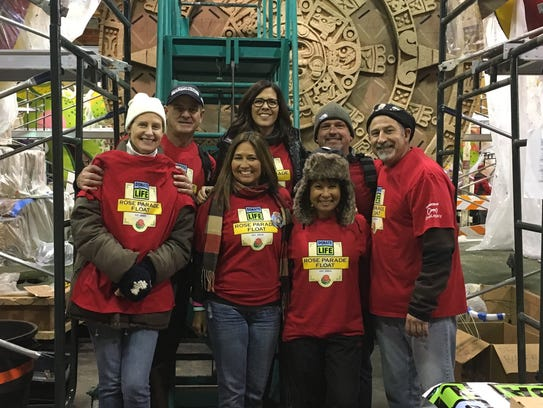 Former Thousand Oaks resident Holly Miyagawa, a kidney recipient, second from left, front row, is seen with friends and co-workers in front of the Donate Life Rose Parade float.