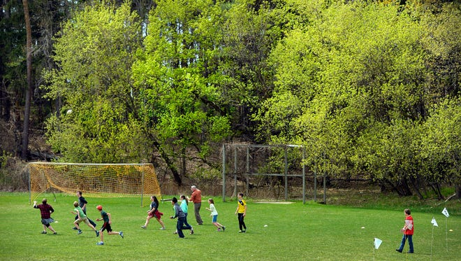 Despite a very dry spring, leaves are beginning to emerge at St. John's Abbey Arboretum as students play soccer Thursday at St. John's Preparatory School in Collegeville. If drought conditions persist, leaves may begin to dry up by July.