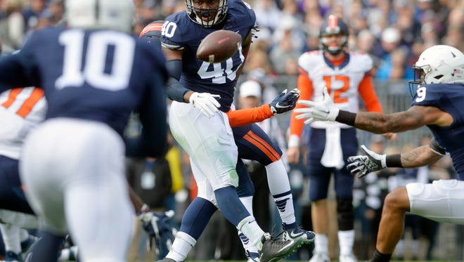 Penn State linebacker Jason Cabinda (40) watches a pass from Illinois quarterback Wes Lunt (12) go awry during the first half of Saturday's 39-0 victory at Beaver Stadium.