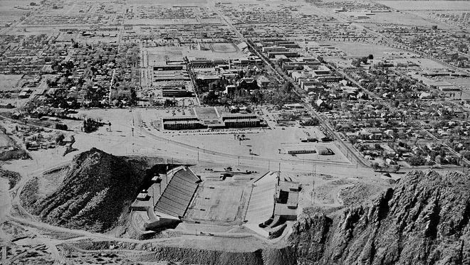 Seen in this 1959 photo, the first iteration of Sun Devil Stadium, nestled between the Buttes was nothing more than a football field flanked by stands on the east and west.  Note in this view looking south, the retaining wall that kept the Salt River from the north end of the field.