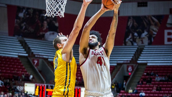 Ball State's Trey Moses goes up for a shot against Toledo's defense during their game at Worthen Arena Tuesday, Jan. 31, 2017.