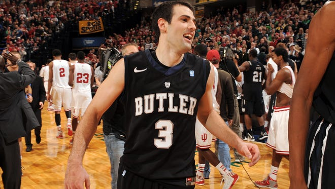 Butler's Alex Barlow, who hit the game winning shot, was all smiles as he left the court as the Bulldogs defeated the Hoosiers 88-86 in overtime of their game during the  2012 Crossroads Classic at Bankers Life Fieldhouse.  Matt Kryger / The Star