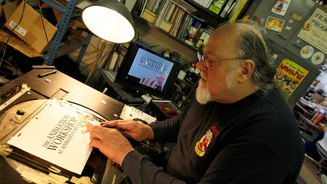 Fred Armstrong, owner of Animatus Studio works on a stop animation promo Feb. 18, 2011 in his studio in Rochester.