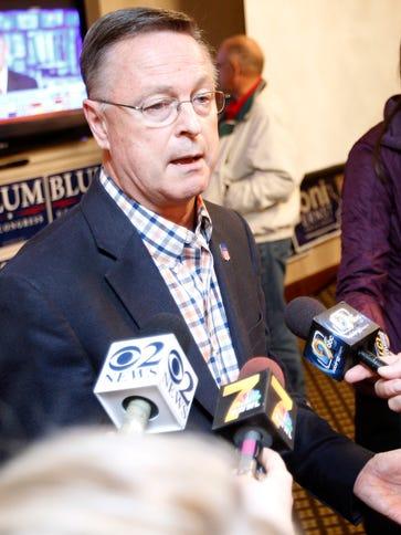 Republican businessman Rod Blum talks with reporters