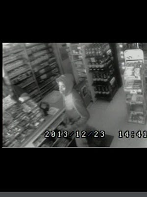 Officials released this screen shot of a security video taken from the area of the Monday, Dec. 23, 2013, bank robbery and shooting that left one Tupelo, Miss., police officer dead and one critically injured.