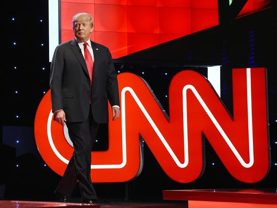 Donald Trump walks on stage during the CNN presidential