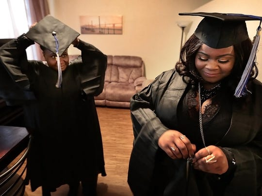 Annie Ivory, 52, (left) and her daughter Pearlina Ivory get ready for the University of Memphis Winter Commencement at the Crescent Bluff Apartments on Sunday afternoon.