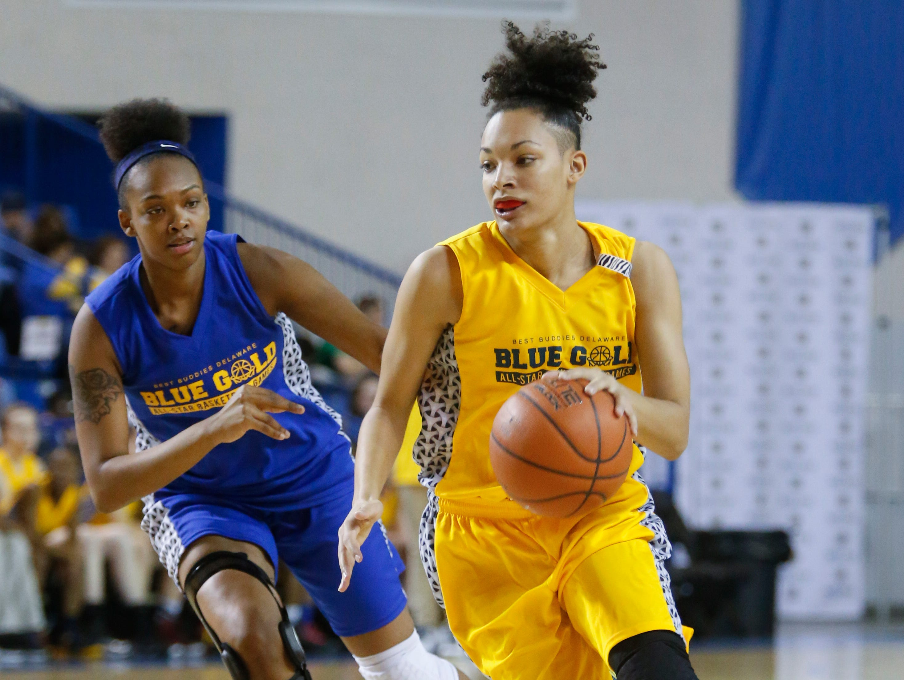 Blue's Al'Kirah Wilson of A.I. du Pont (left) defends as Gold's Melena Credle of Smyrna pushes the ball into the offensive zone in the first half of the Blue-Gold All-Star Basketball game at the Bob Carpenter Center Saturday.