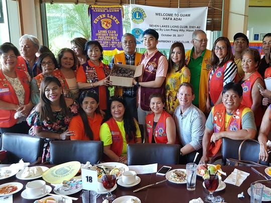 Donation of New Eyeglasses for Children: Guam Harmony Lions Club of LCI District 204 presented a box of 104 new children eyeglasses, courtesy of Lion Flora Smithers of 20-20 Vision, to their twin club, Seven Lakes Lions Club District 301-A-2 Philippines at the welcome luncheon Oct. 28 at La Cascata, Sheraton Resort & Spa. The joint humanitarian community project by both Lions Clubs will be a continuing crusade against darkness by helping restore vision and fight preventative blindness esp. on children of prekindergarten to 6th grade in the province of San Pablo Laguna City, Philippines. Lions around the world had been addressing Sight Conservation to people in need through Lions Clubs International Foundation with grants by conducting vision screening and providing eyeglasses.