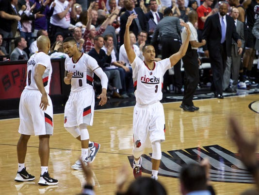 Portland Trail Blazers guard C.J. McCollum reacts after making a 3-point basket against the Los Angeles Clippers during the second half of Game 6 of an NBA basketball first-round playoff series Friday, April 29, 2016, in Portland, Ore. The Trail Blazers won 106-103. (AP Photo/Craig Mitchelldyer)