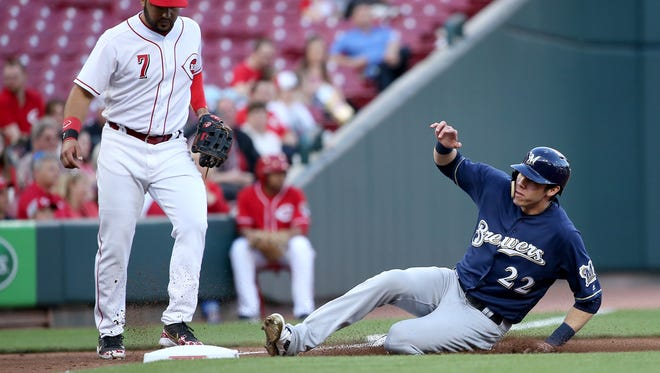 Milwaukee Brewers center fielder Christian Yelich (22) advances to third base safely in the third inning during a National League baseball game between the Milwaukee Brewers and the Cincinnati Reds, Monday, April 30, 2018, at Great American Ball Park in Cincinnati.