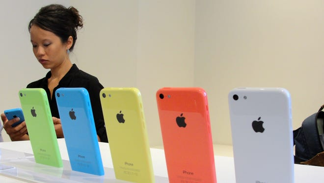 The new lower-cost iPhone 5c is shown at an iPhone event at Apple's headquarters in Cupertino, Calif.
