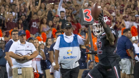 Shamad Lomax and the New Mexico State football team
