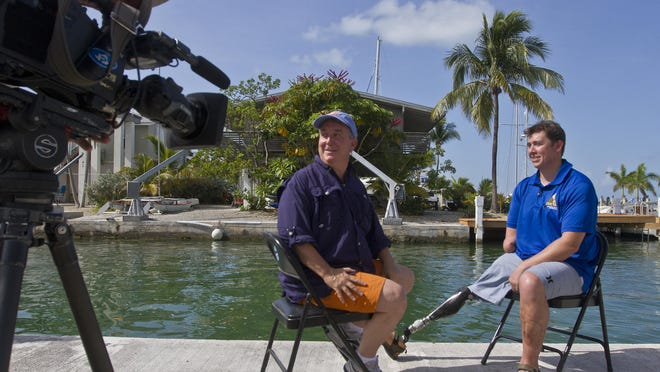 """Bobby Dove, 28, a Green Beret who lost hist right arm and right leg during and IED attack on 2012 in Afghanistan, is interviewed by """"Today Show"""" reporter Kerry Sanders prior to participating on a dive to help plant staghorn coral fragments as part of Mote Marine Laboratories ongoing reef restoration project."""