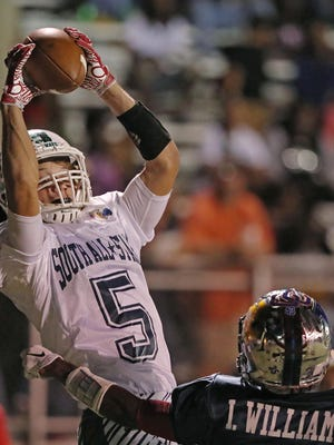 Dawson Degroot, a Fort Myers High School player makes a leaping catch in the end zone to score a touchdown Wednesday evening during the Rotary South All Star game.