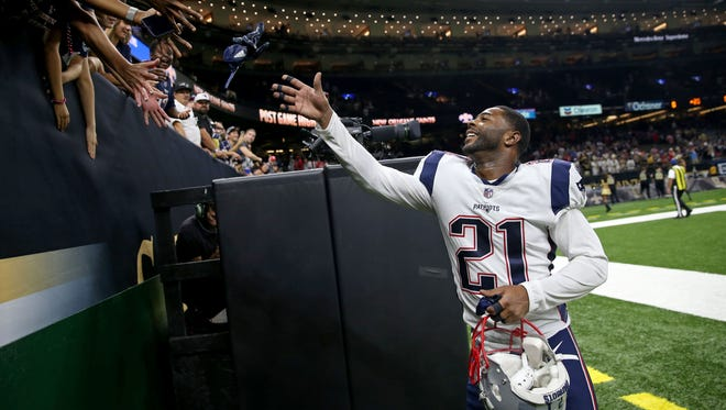 New England Patriots cornerback Malcolm Butler (21) throws his gloves to fans after their game against the New Orleans Saints at the Mercedes-Benz Superdome. Butler is from Vicksburg.