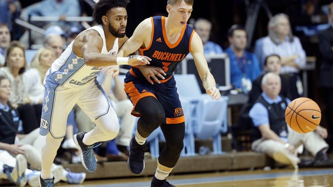 North Carolina's Joel Berry II, left, and Bucknell's Jimmy Sotos (3) chase a loose ball during the first half of an NCAA college basketball game in Chapel Hill, N.C., Wednesday, Nov. 15, 2017. (AP Photo/Gerry Broome)