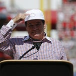 "2016 Reds Hall of Fame inductee Pete Rose points to the ""C"" logo during June 25 pregame ceremonies at Great American Ball Park in Cincinnati."