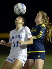 Spencerport's Erin Coykendall, right.