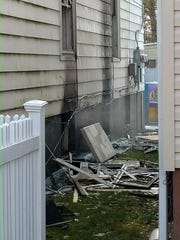 Scenes from Friday morning fire on Mansion Street,