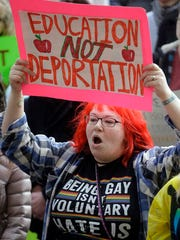 Demonstrators hold a rally Monday, Feb. 20, 2017, in Salt Lake City. The rally is one of several Not My Presidents Day protests planned across the country to mark the Presidents Day holiday. Protesters are criticizing President Donald Trump's immigration policies, among other things.