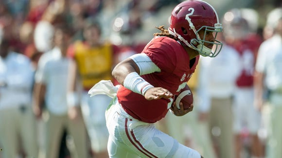 Alabama quarterback Jalen Hurts (2) carries against Mississippi State at Bryant Denny Stadium in Tuscaloosa, Ala. on Saturday November 12, 2016.