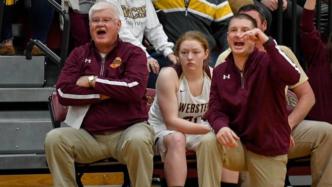 Webster County girls coach Brandon Fisher (right) with his dad Tom Fisher coaching on the bench as the Webster County Lady Trojans play the Hopkinsville Lady Tigers in the Second Region semifinals in Dixon Friday, March 2, 2018.